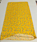 Bright yellow feedsack, intact, with