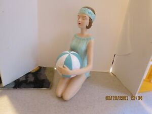 SEATED BATHING BEAUTY FIGURINE IN TURQUISE  SWIM SUIT  WITH BALL