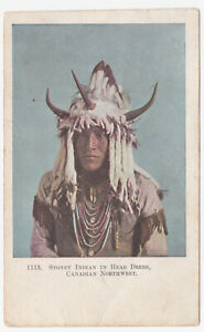 OLD POSTCARD OF STONEY INDIAN IN HEAD DRESS  CANADIAN NORTHWEST CANADA