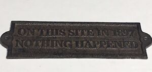 "Brown/Rust ""On this Site in 1897 Nothing Happened"" Cast Iron Plaque Sign 9""x3"""