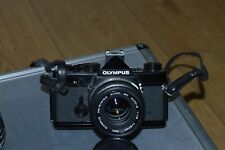 Olympus OM1 (Black Body) 35mm SLR Film Camera with 28, 50mm & 70-300m lens.