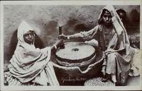India Native Women Grinding Corn c1910 Real Photo Postcard dcn