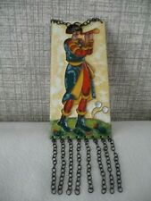 Russian enamel & copper decorative hanging of a piper