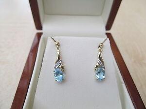 9ct Y/gold Blue Topaz & Diamond drop Earrings