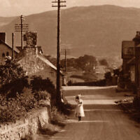 Vintage 1930s RPPC  Welsh Village Street Woman Postcard Wales United Kingdom