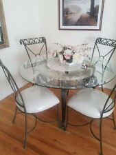 Glass top, marble and wrought iron base Dining Table and 4 chairs.hardly used..
