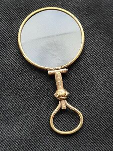 antique gilt metal quizzing or magnifying glass