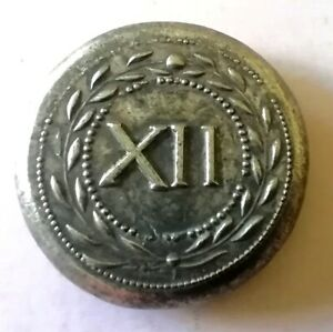 Roman Spintria (plural spintriae) Token (XII) circa 22 to 47 AD