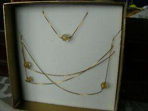 Parure Noa Cacharel collier et bracelet numéroté perles en verres et feuille or