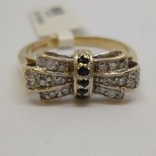 9ct yellow gold beautiful bow ring with sapphire and synthetic diamond.