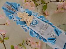 Taufkerze sculpté bleu clair avec ange pour garçon avec nom et date