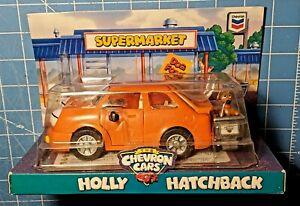 1997 The Chevron Cars- Holly Hatchback w/ Dog & Shopping Cart Collectible~ NIP