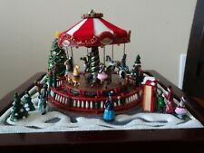 Gold Label Music Box-Christmas Carousel. Plays 48 songs in three sounds.