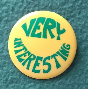 VERY INTERESTING yellow LAUGH-IN pin button TV comedy vintage 1960s Rowen Martin