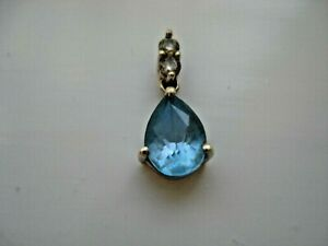 9ct White Gold Blue Topaz And Diamond Pendant