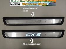 Mazda CX-5 Aluminum Scuff Plates with an illuminated CX-5 logo (Set of 2)
