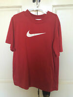 Nike dri fit short sleeve shirt/Boys size med/red with white swoosh symbol