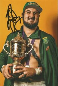 SOUTH AFRICA RUGBY: LOOD DE JAGER SIGNED 6x4 WORLD CUP TROPHY PHOTO+COA *PROOF*