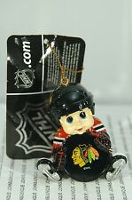 CHICAGO BLACKHAWK HOCKEY BOY HOLDING PUCK ORNAMENT~NEW~FREE SHIPPING IN THE US~