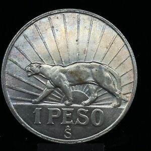 1942 so Uruguay 1 Peso Silver GEM BU. Puma Coin KM#30 #1