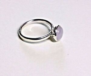 A Hand made solid sterling silver ring with an 8 mm rose quartz stone, size M,