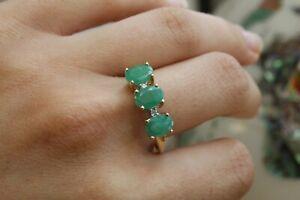 9ct yellow gold three stone oval emerald with round brilliant diamond ring 2.2g