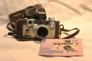 vintage argus c3 camera, with light meter, case and manual