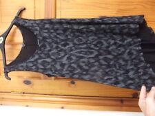 New PAPAYA size 10 long flared loose top black silver animal print? longer back