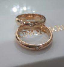 Coppia fedi Unoaerre 10+10 grammi in oro giallo 750 18 kt e diamanti ct 0.05