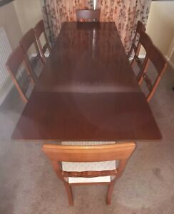 Walnut Veneer extending dining table with 8 chairs. H80 W84 L154 open L242