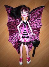 Jolie poupée MONSTER HIGH de Draculaura comme NEUVE transformation chauve-souris