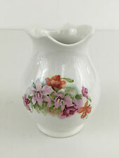 White ceramic toothbrush holder - floral pattern