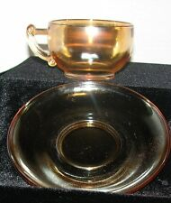 Peach Luster ware Glass Teacup cup and Saucer