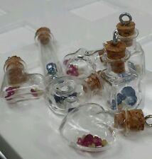 Tresery crystal bottle with ruby,sapphire, Emeralds,diamonds pendant.24 bottles.
