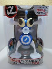 Zizzle iZ Interactive Electronic Musical Toy Speaker Blue Alien New in Worn Box