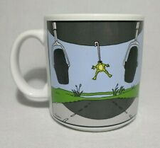 More details for the far side mug 'frog stuck under airplane by tongue' by gary larson 1984
