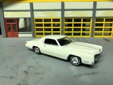 1/64 67 Cadillac Eldorado in White/ Blk  Int / Rubber Wide WW/Stock Hubcaps