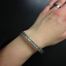 Vintage silver tone bangle with clip clasp