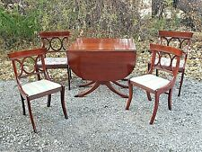 Duncan Phyfe Vintage Mahogany double drop leaf table & ornate chairs