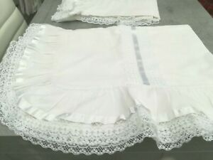 Stunning White Pillowcases with frilled lace edge and ribbon in white