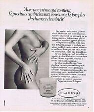 PUBLICITE ADVERTISING 025 1977 CLARINS  seins nus crème multi-réductrice
