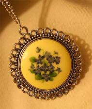 Lovely Circle Rimmed Silvertone Cream & Violet Sweet Pea Flower Pendant Necklace