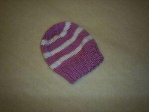 Handknitted baby girls hat