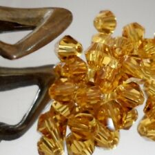 25 Perles Cristal -TOUPIES SWAROVSKI - TOPAZ - 4mm