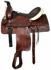 "16"" Buffalo roper style saddle with silver laced rawhide cantle and pommel"