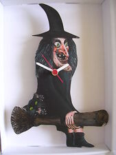 WITCH WITH BLACK CAT ON BROOMSTICK WALL CLOCK. NEW AND BOXED.