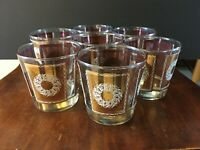 Vintage set of six whiskey glasses Libbey gold ovals with white wreaths.