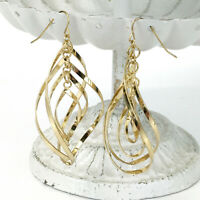"KINETIC gold-tone twisted dangle earrings - four concentric shapes 2.5"" long"