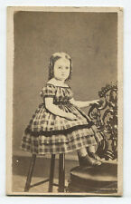 MOON PIE FACED YOUNG GIRL IN PLAID DRESS. SALEM, OHIO.