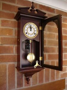 TIMEMASTER PENDULUM STRICKING WALL CLOCK.